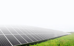 Solar power modules on a field ready for a solar inspection by greentech