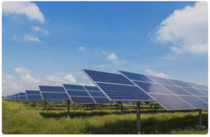 Commercial solar power plant modules on a green field
