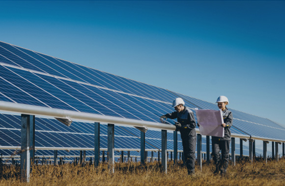 greentech enigeers inspecting the construcion of a commercial solar plant