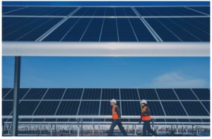 greentech engineers inspecting a commercial solar plant project for a due diligence report