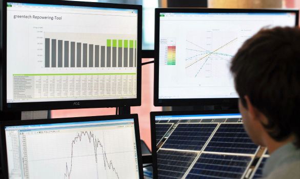 greentech engineer monitoring a commercial solar power plant with several tools and analysis