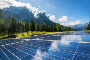 Commercial solar plant in mountain setting ready to be inspected by greentech engineers based on a due diligence inspection