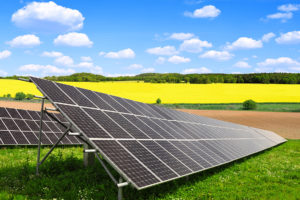 Solar drone recording PV modules from a commercial power plant on a field